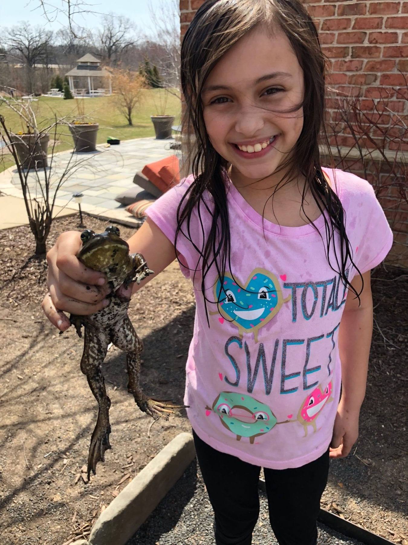 Sophia with a frog